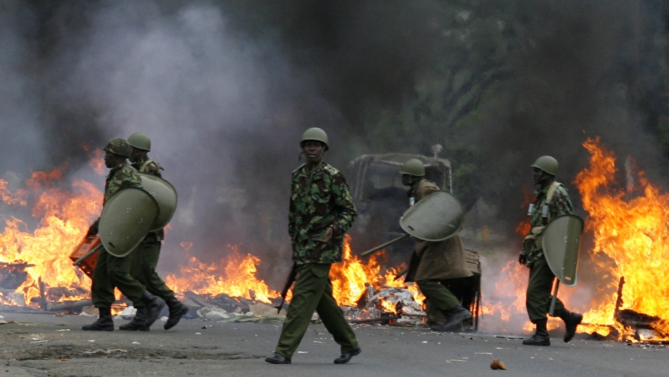 Riot police move to dismantle a burning roadblock in Nairobi, Kenya on Dec. 31, 2007; lessons for Africa