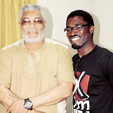 President Rawlings in a pose with our staff writer  Sacut Amenga-Etego