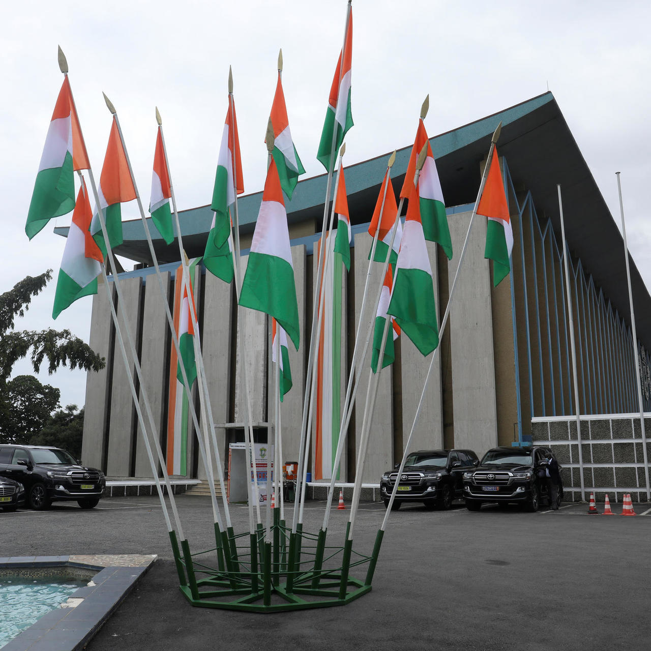 File photo of Ivory Coast's flags next to the presidential palace on the country's Independence Day, in Abidjan, Ivory Coast August 7, 2020. REUTERS - LUC GNAGO